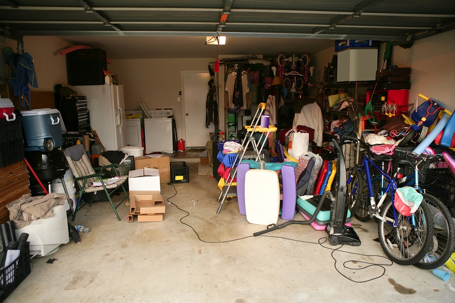 messy abandoned garage full of stuff chaos at home